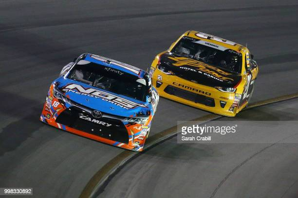 Kyle Busch driver of the NOS Energy Drink Toyota leads Daniel Hemric driver of the South Point Hotel Casino Chevrolet during the NASCAR Xfinity...