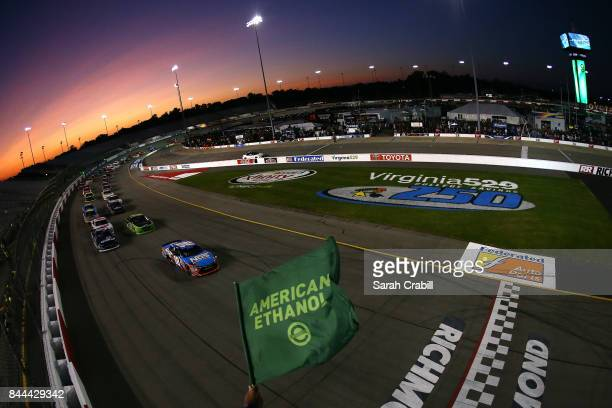 Kyle Busch driver of the NOS Energy Drink Toyota takes the green flag to start the NASCAR XFINITY Series Virginia529 College Savings 250 at Richmond...