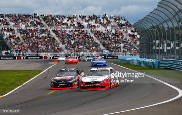 Kyle Busch driver of the NOS Rowdy Toyota and Brad Keselowski driver of the REV/Fleetwood Ford battle for the lead during the NASCAR XFINITY Series...