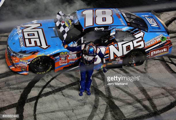 Kyle Busch driver of the NOS Rowdy Toyota celebrates with the checkered flag after winning the NASCAR XFINITY Series Food City 300 at Bristol Motor...