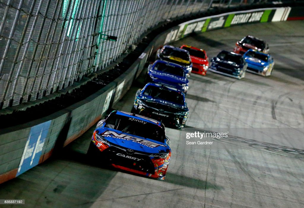 Kyle Busch, driver of the #18 NOS Rowdy Toyota, leads a pack of cars during the NASCAR XFINITY Series Food City 300 at Bristol Motor Speedway on August 18, 2017 in Bristol, Tennessee.