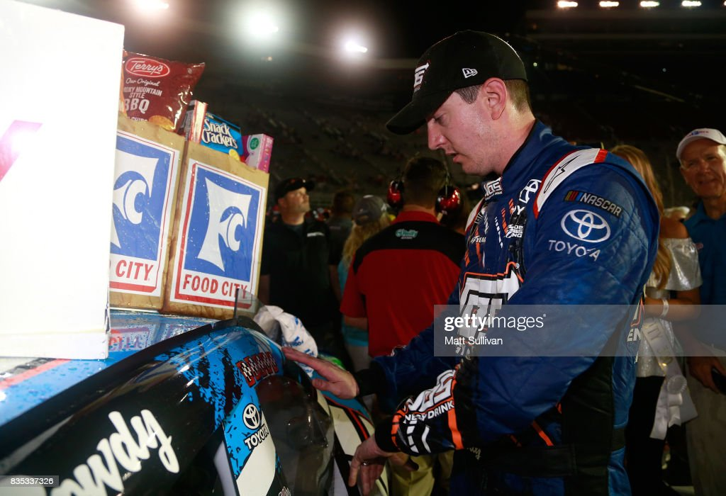 Kyle Busch, driver of the #18 NOS Rowdy Toyota, poses with the winners sticker after winning the NASCAR XFINITY Series Food City 300 at Bristol Motor Speedway on August 18, 2017 in Bristol, Tennessee.