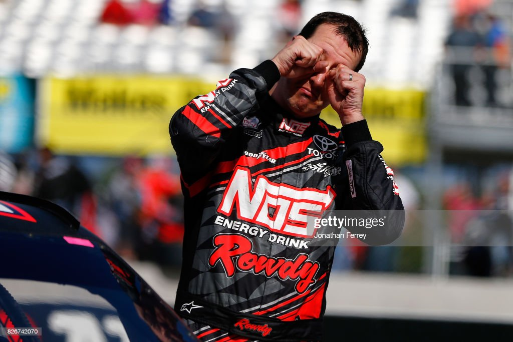 Kyle Busch, driver of the #18 NOS Rowdy Toyota, pretends to cry after be booed by the crowd after winning the NASCAR XFINITY Series Zippo 200 at The Glen at Watkins Glen International on August 5, 2017 in Watkins Glen, New York.