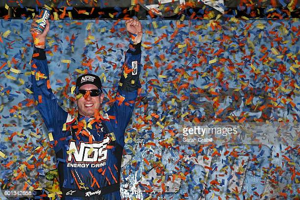 Kyle Busch, driver of the NOS Toyota, celebrates in Victory Lane after winning the NASCAR XFINITY Series Virginia529 College Savings 250 at Richmond...