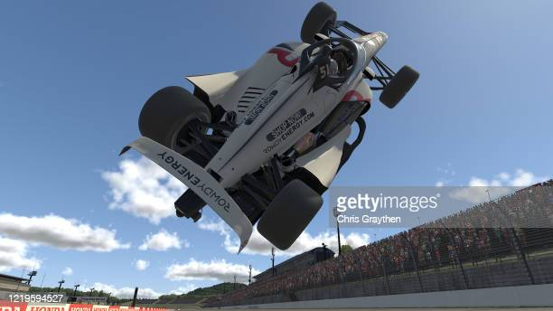 Kyle Busch driver of the Rowdy Energy Dallara flips in the air during the IndyCar iRacing Challenge Firestone 175 at virtual Twin Ring Motegi on...