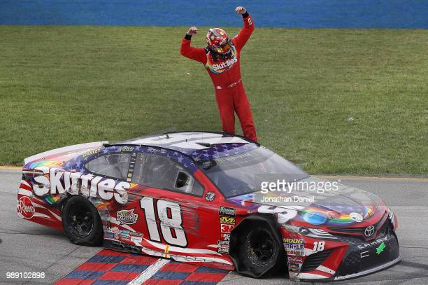 Kyle Busch driver of the Skittles Red White Blue Toyota celebrates after winning the Monster Energy NASCAR Cup Series Overton's 400 at Chicagoland...