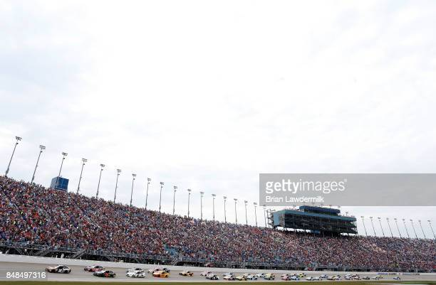 Kyle Busch driver of the Skittles Sweet Heat Toyota leads the field to turn one after taking the green flag to start the Monster Energy NASCAR Cup...