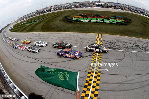 Kyle Busch driver of the Skittles Sweet Heat Toyota leads the field to the green flag during the Monster Energy NASCAR Cup Series Tales of the...