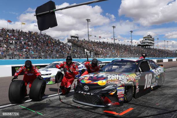 Kyle Busch driver of the Skittles Sweet Heat Toyota pits during the Monster Energy NASCAR Cup Series TicketGuardian 500 at ISM Raceway on March 11...