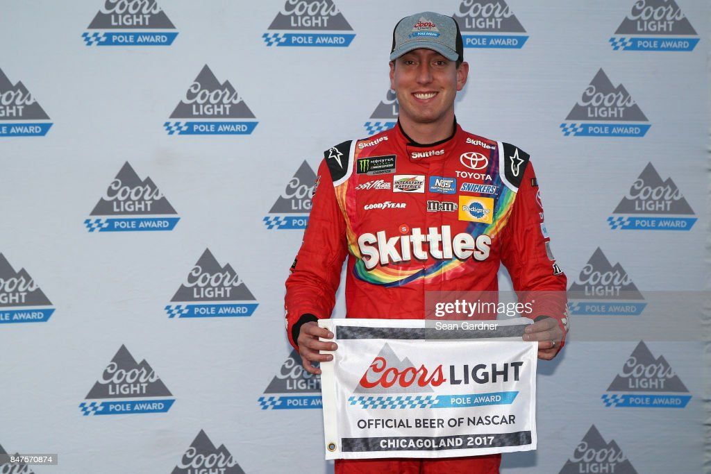 Kyle Busch, driver of the #18 Skittles Sweet Heat Toyota, poses with the Coors Light Pole Award after qualifying in the pole position for the Monster Energy NASCAR Cup Series Tales of the Turtles 400 at Chicagoland Speedway on September 15, 2017 in Joliet, Illinois.