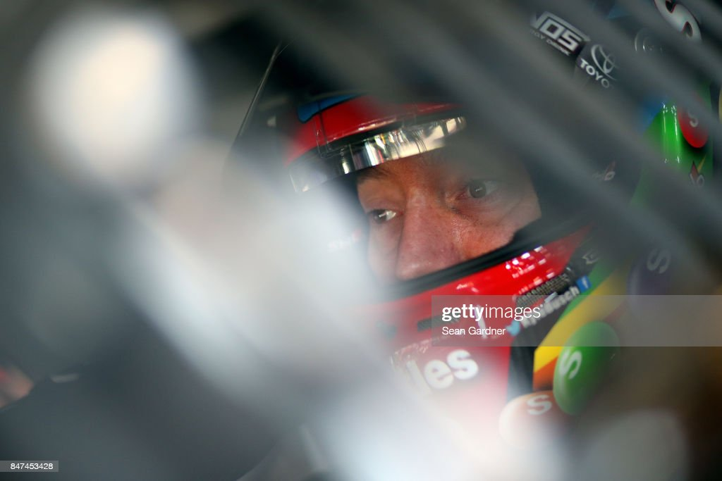 Kyle Busch, driver of the #18 Skittles Sweet Heat Toyota, sits in his car during practice for the Monster Energy NASCAR Cup Series Tales of the Turtles 400 at Chicagoland Speedway on September 15, 2017 in Joliet, Illinois.