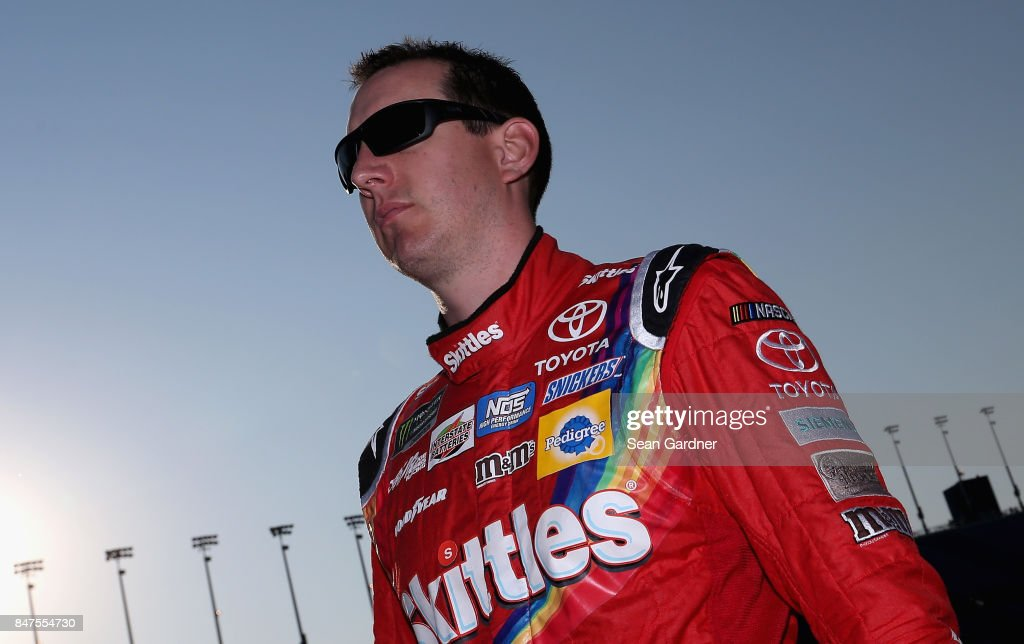 Kyle Busch, driver of the #18 Skittles Sweet Heat Toyota, walks on the grid during qualifying for the Monster Energy NASCAR Cup Series Tales of the Turtles 400 at Chicagoland Speedway on September 15, 2017 in Joliet, Illinois.