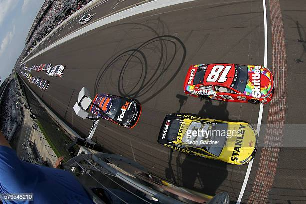 Kyle Busch driver of the Skittles Toyota and Carl Edwards driver of the Stanley Toyota lead the field to the green flag to start the NASCAR Sprint...