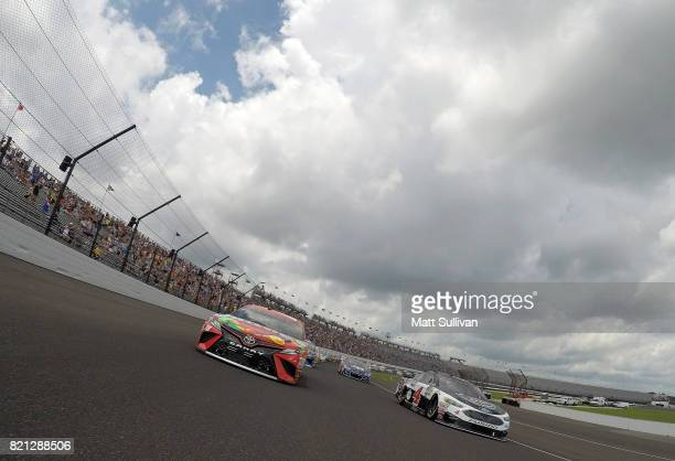 Kyle Busch driver of the Skittles Toyota and Kevin Harvick driver of the Jimmy John's Ford lead the field during pace laps prior to the Monster...