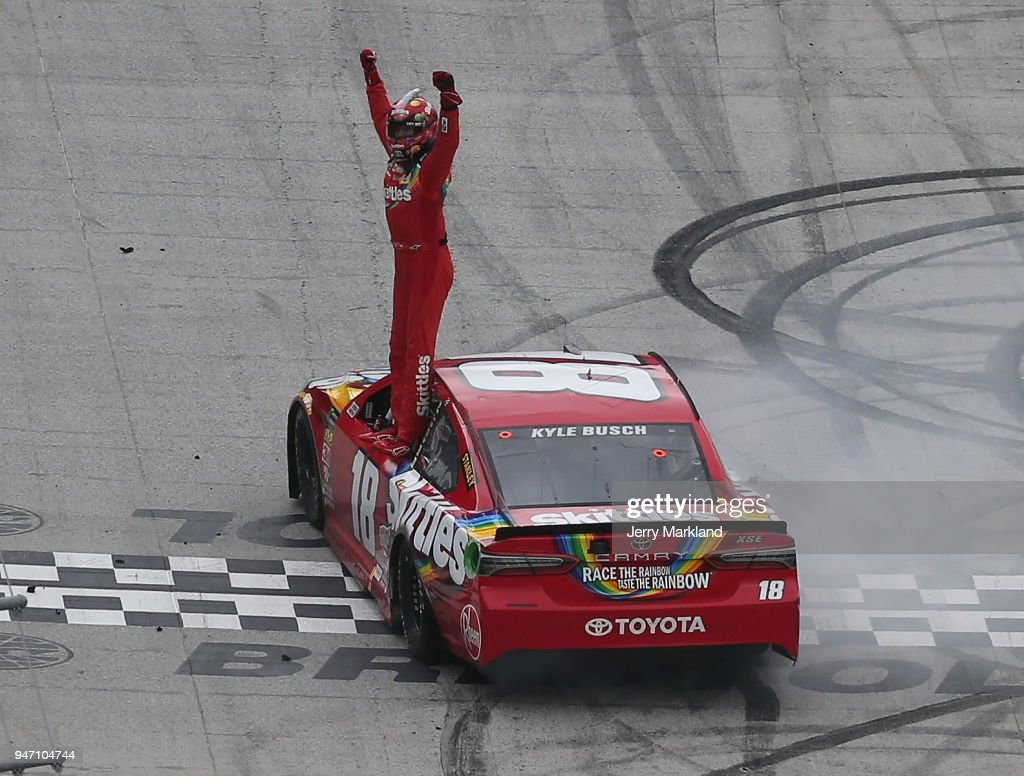 Kyle Busch, driver of the #18 Skittles Toyota, celebrates after winning the rain delayed Monster Energy NASCAR Cup Series Food City 500 at Bristol Motor Speedway on April 16, 2018 in Bristol, Tennessee.