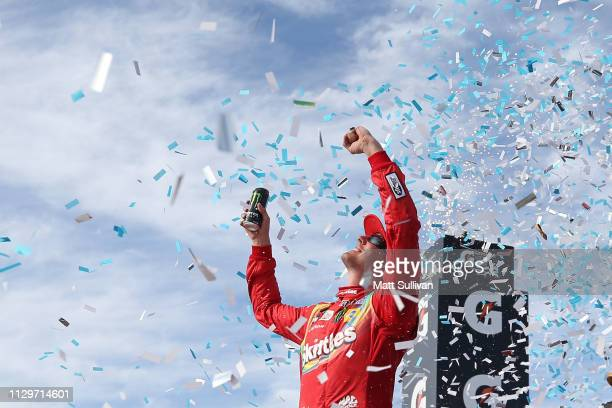 Kyle Busch driver of the Skittles Toyota celebrates in Victory Lane after winning the Monster Energy NASCAR Cup Series TicketGuardian 500 at ISM...