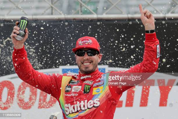 Kyle Busch driver of the Skittles Toyota celebrates in Victory Lane after winning the Monster Energy NASCAR Cup Series Food City 500 at Bristol Motor...