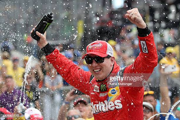 Kyle Busch driver of the Skittles Toyota celebrates in Victory Lane after winning the NASCAR Sprint Cup Series Crown Royal Presents the Jeff Kyle 400...