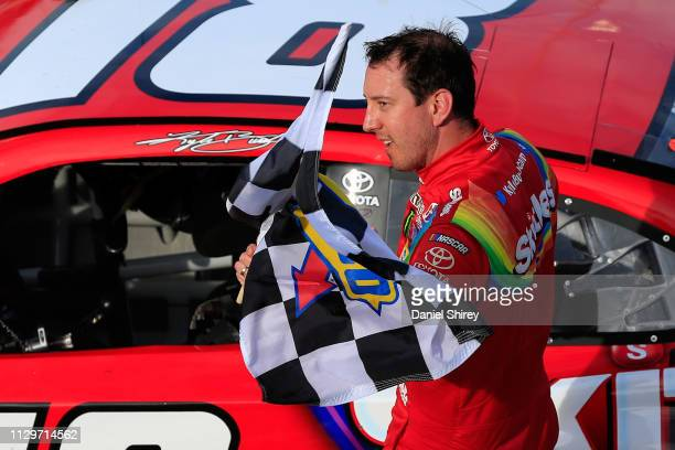 Kyle Busch driver of the Skittles Toyota celebrates winning the Monster Energy NASCAR Cup Series TicketGuardian 500 at ISM Raceway on March 10 2019...