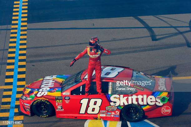 Kyle Busch, driver of the Skittles Toyota, celebrates winning the Monster Energy NASCAR Cup Series TicketGuardian 500 at ISM Raceway on March 10,...