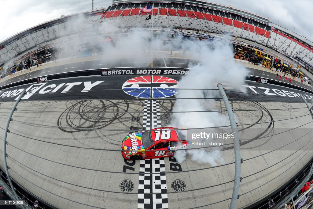 Kyle Busch, driver of the #18 Skittles Toyota, celebrates with a burnout after winning the rain delayed Monster Energy NASCAR Cup Series Food City 500 at Bristol Motor Speedway on April 16, 2018 in Bristol, Tennessee.