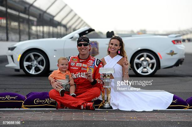 Kyle Busch driver of the Skittles Toyota celebrates with his wife Samantha and son Brexton after winning the NASCAR Sprint Cup Series Crown Royal...