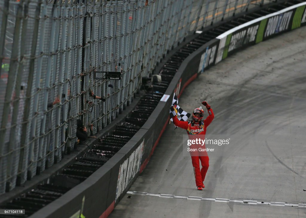 Kyle Busch, driver of the #18 Skittles Toyota, celebrates with the checkered flag after winning the rain delayed Monster Energy NASCAR Cup Series Food City 500 at Bristol Motor Speedway on April 16, 2018 in Bristol, Tennessee.