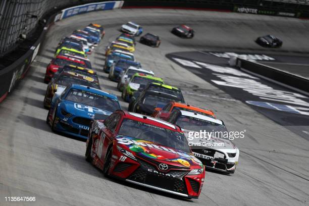 Kyle Busch driver of the Skittles Toyota leads a pack of cars during the Monster Energy NASCAR Cup Series Food City 500 at Bristol Motor Speedway on...