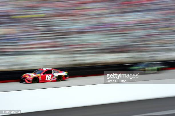 Kyle Busch driver of the Skittles Toyota leads Kurt Busch driver of the Monster Energy Chevrolet during the Monster Energy NASCAR Cup Series Food...