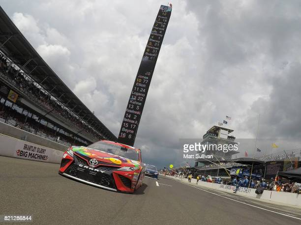 Kyle Busch driver of the Skittles Toyota leads the field off the grid prior to the Monster Energy NASCAR Cup Series Brickyard 400 at Indianapolis...