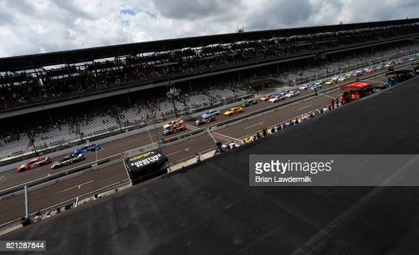 Kyle Busch driver of the Skittles Toyota leads the field to start the Monster Energy NASCAR Cup Series Brickyard 400 at Indianapolis Motorspeedway on...