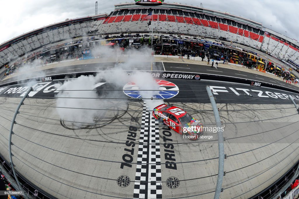 Kyle Busch, driver of the #18 Skittles Toyota makes a burn out in celebration afte winningr the rain delayed Monster Energy NASCAR Cup Series Food City 500 at Bristol Motor Speedway on April 16, 2018 in Bristol, Tennessee.