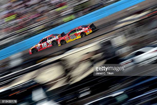 Kyle Busch driver of the Skittles Toyota races Dale Earnhardt Jr driver of the Axalta Chevrolet during the NASCAR Sprint Cup Series Good Sam 500 at...