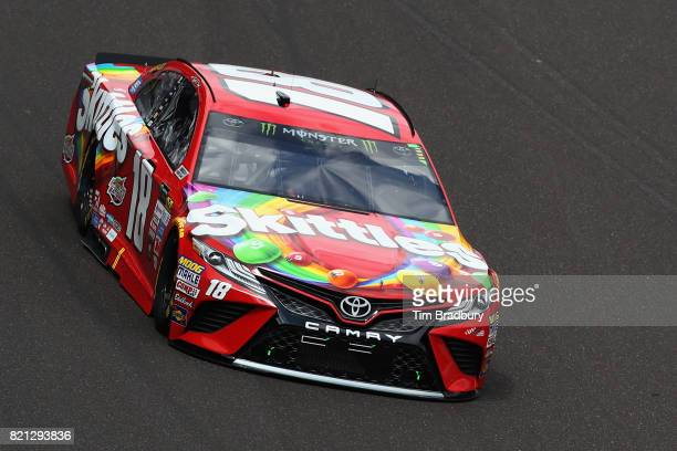 Kyle Busch driver of the Skittles Toyota races during the Monster Energy NASCAR Cup Series Brickyard 400 at Indianapolis Motorspeedway on July 23...