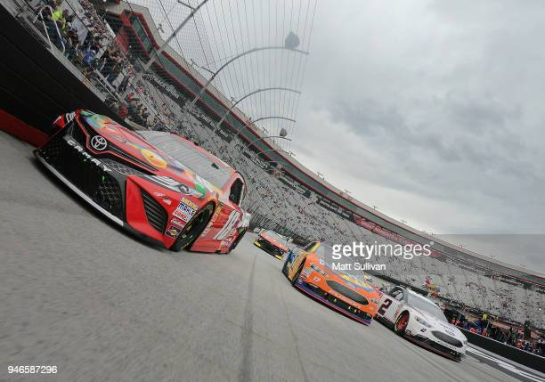 Kyle Busch driver of the Skittles Toyota Ricky Stenhouse Jr driver of the SunnyD Ford and Brad Keselowski driver of the Discount Tire Ford take a...