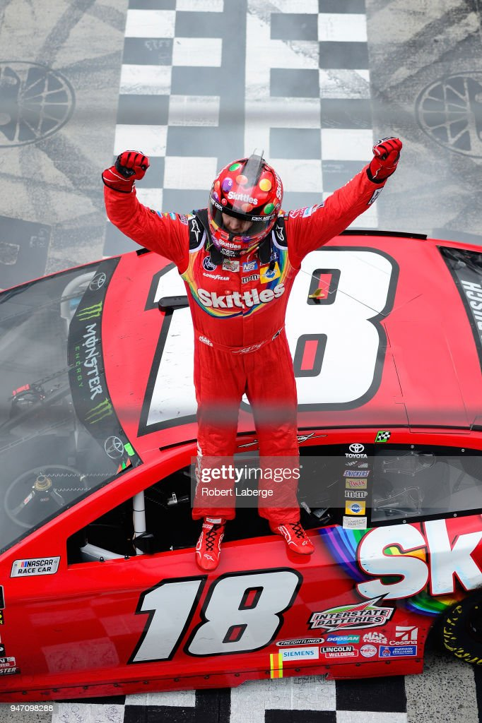 Kyle Busch, driver of the #18 Skittles Toyota stands on his car in celebration after winning the rain delayed Monster Energy NASCAR Cup Series Food City 500 at Bristol Motor Speedway on April 16, 2018 in Bristol, Tennessee.