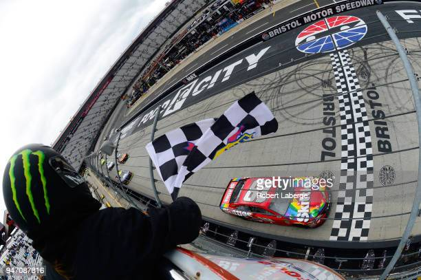 Kyle Busch driver of the Skittles Toyota takes the checkered flag to win the rain delayed Monster Energy NASCAR Cup Series Food City 500 at Bristol...