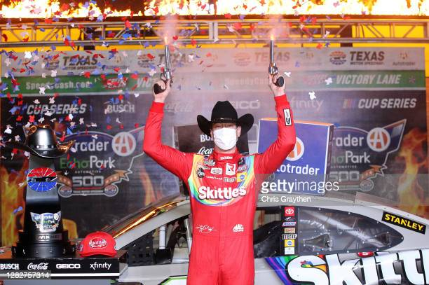 Kyle Busch, driver of the Skittles Zombie Toyota, celebrates in victory lane after winning the NASCAR Cup Series Autotrader EchoPark Automotive 500...