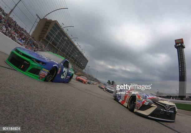 Kyle Busch driver of the Snickers Almond Toyota and Ryan Newman driver of the Liberty National Chevrolet lead the field under caution prior to the...