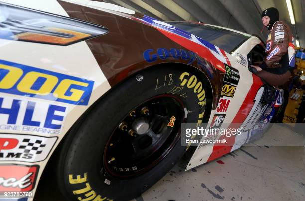 Kyle Busch driver of the Snickers Almond Toyota climbs into his car during practice for the Monster Energy NASCAR Cup Series Folds of Honor QuikTrip...