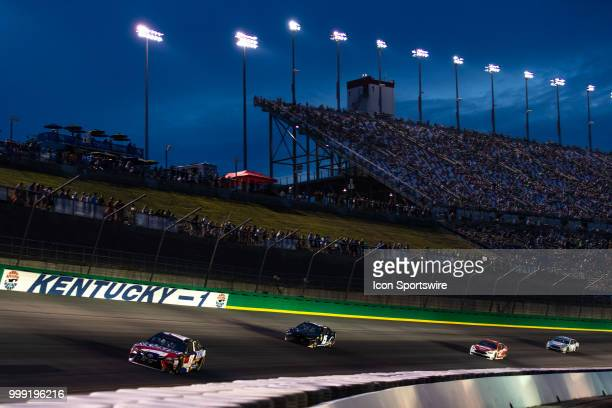 Kyle Busch driver of the Snickers Intense Toyota heads into turn one during the Monster Energy NASCAR Cup Series Quaker State 400 presented by...