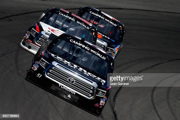 Kyle Busch driver of the Textron Off Road Toyota leads a pack of trucks during the NASCAR Camping World Truck Series LTi Printing 200 at Michigan...