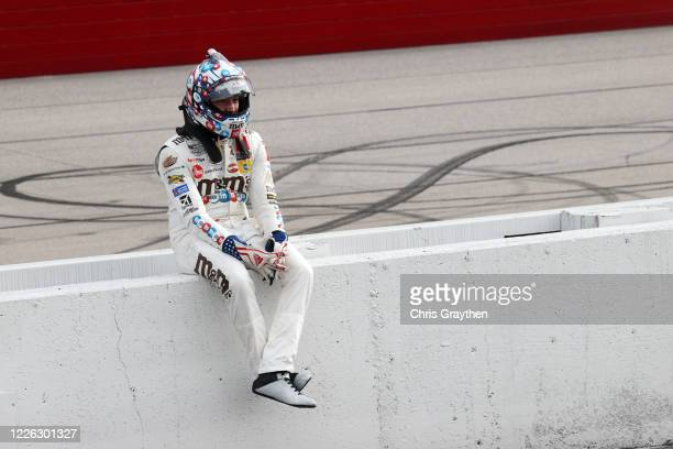 Kyle Busch, driver of the Thank You Heroes/M&M's Toyota, sits on the wall after the NASCAR Xfinity Series Toyota 200 at Darlington Raceway on May 21,...