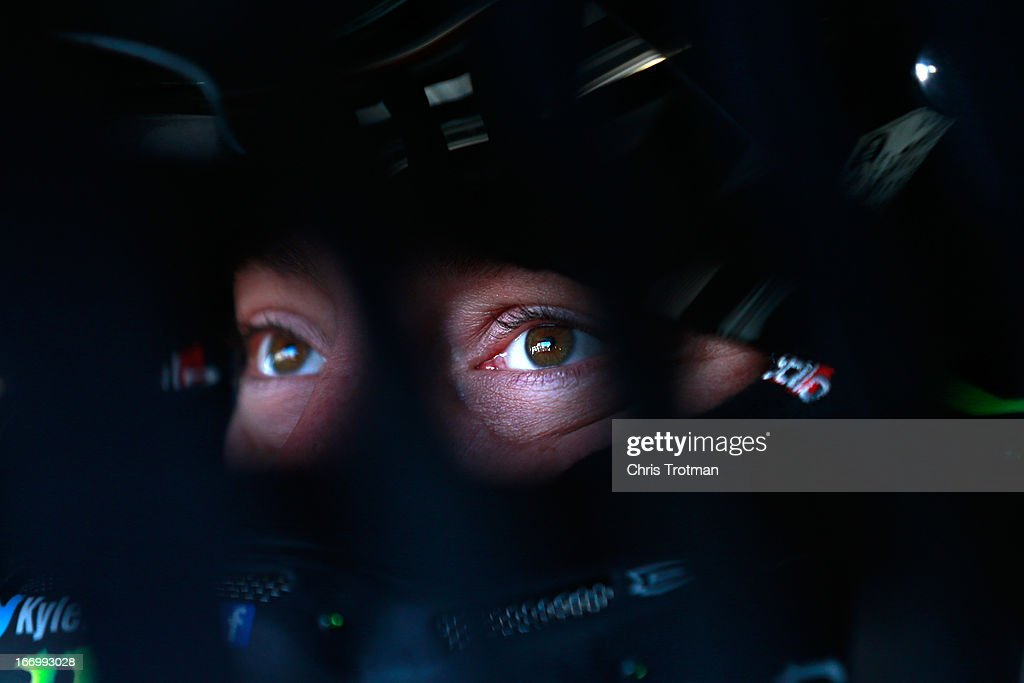 Kyle Busch, driver of the #51 Toyota Care Toyota, sits in car in the garage area during practice for the NASCAR Camping World Truck Series SFP 250 at Kansas Speedway on April 19, 2013 in Kansas City, Kansas.