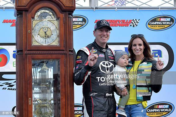 Kyle Busch driver of the Toyota Toyota poses with his son Brexton and his wife Samantha in Victory Lane after winning the NASCAR Camping World Truck...