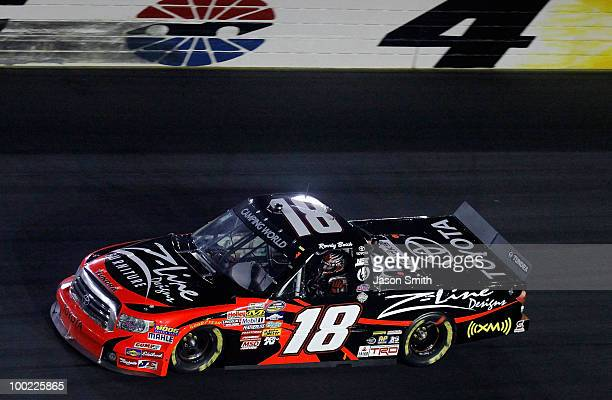 Kyle Busch driver of the Toyota Tundra/ZLine Designs Toyota celebrates on track after winning the NASCAR Camping World Truck Series North Carolina...