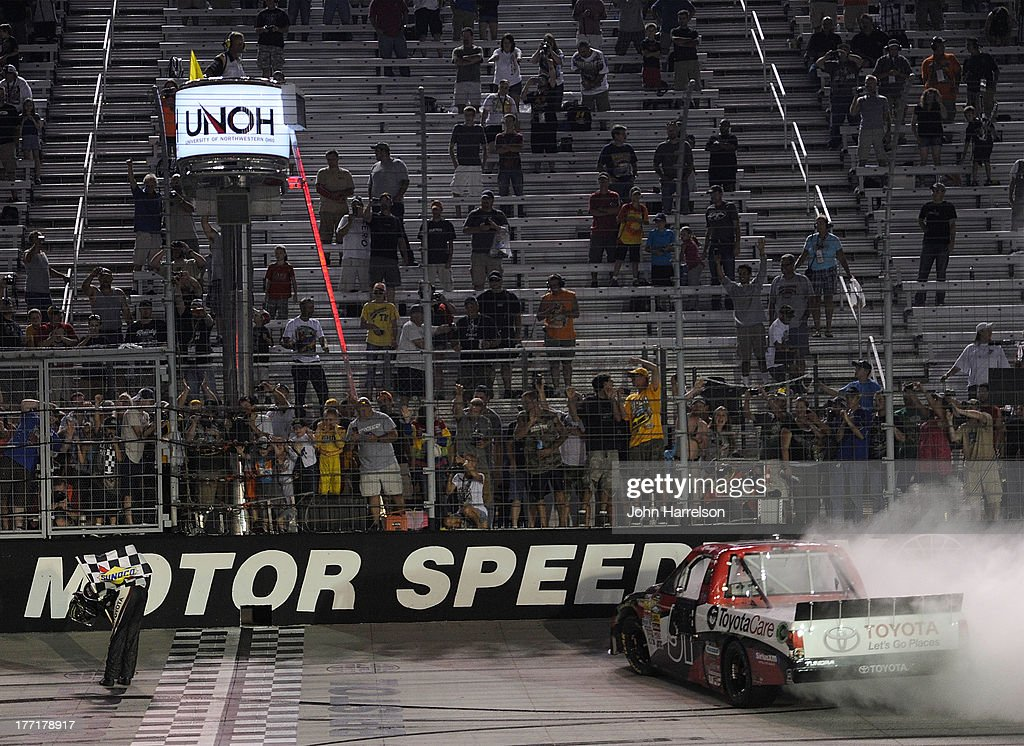 Kyle Busch, driver of the #51 ToyotaCare Toyota, celebrates after winning the Camping World Truck Series UNOH 200 at Bristol Motor Speedway on August 21, 2013 in Bristol, Tennessee.