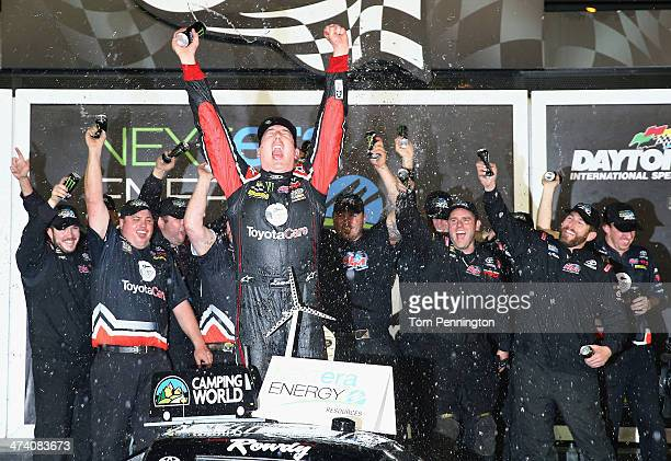 Kyle Busch driver of the ToyotaCare Toyota celebrates in Victory Lane after winning during the Camping World Truck Series NextEra Energy Resources...