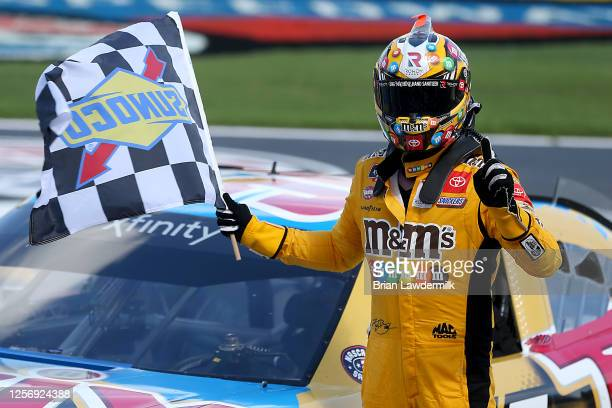 Kyle Busch, driver of the Twix Cookies & Creme Toyota, celebrates winning the NASCAR Xfinity Series Bariatric Solutions 300 at Texas Motor Speedway...