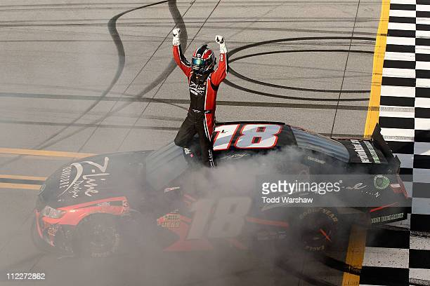 Kyle Busch driver of the ZLine Designs Toyota celebrates after winning the NASCAR Nationwide Series Aaron's 312 at Talladega Superspeedway on April...